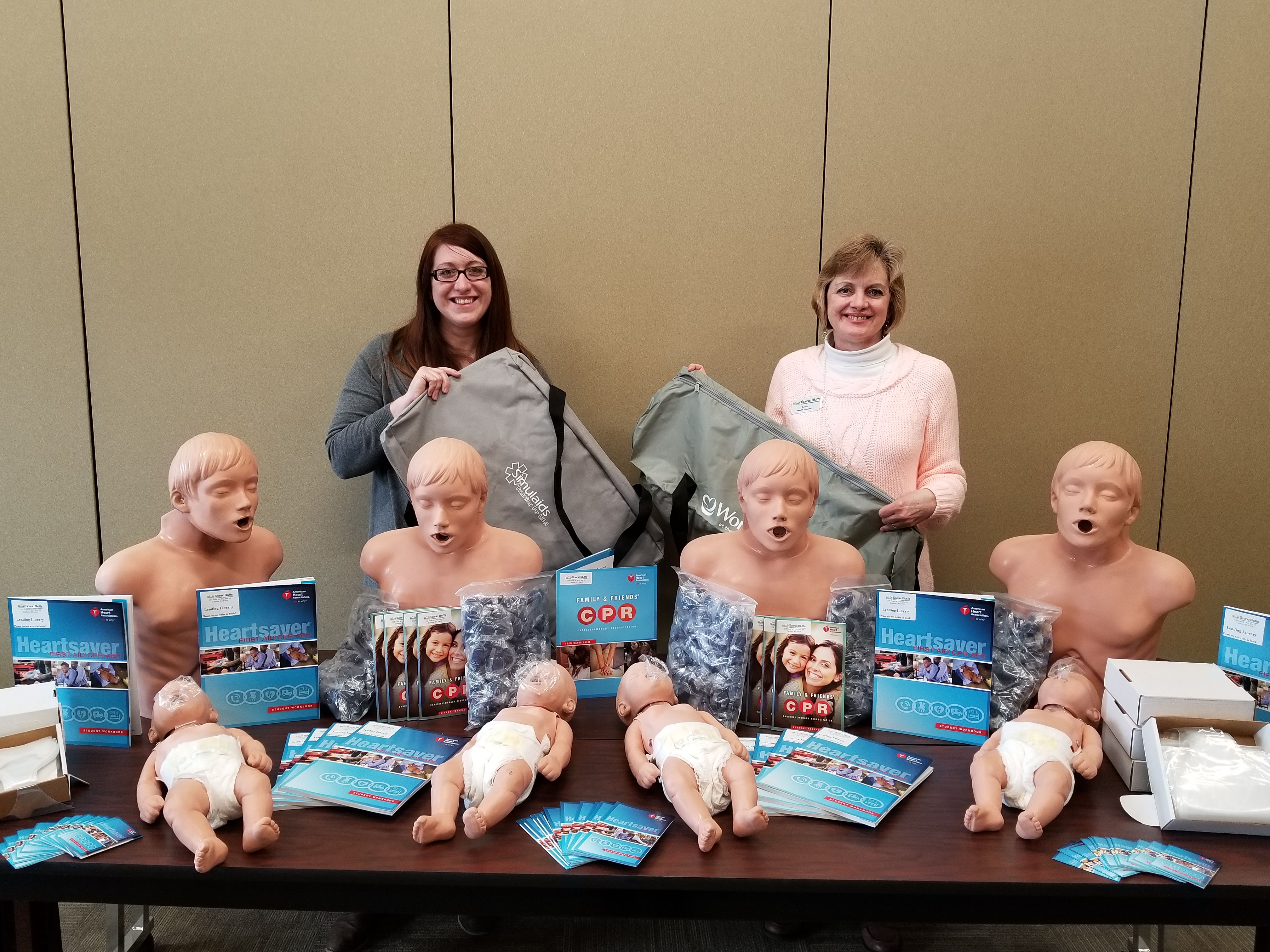 Ashley Hemmersbach and Anne Heatlh, Health Educators, pose with new cpr equipment